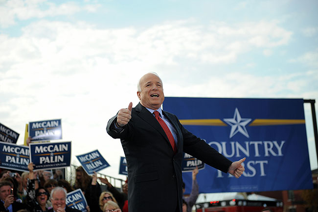 US Republican presidential candidate John McCain waves to supporters at a campaign rally at New Town at St. Charles in St. Charles, Missouri, on October 20, 2008.