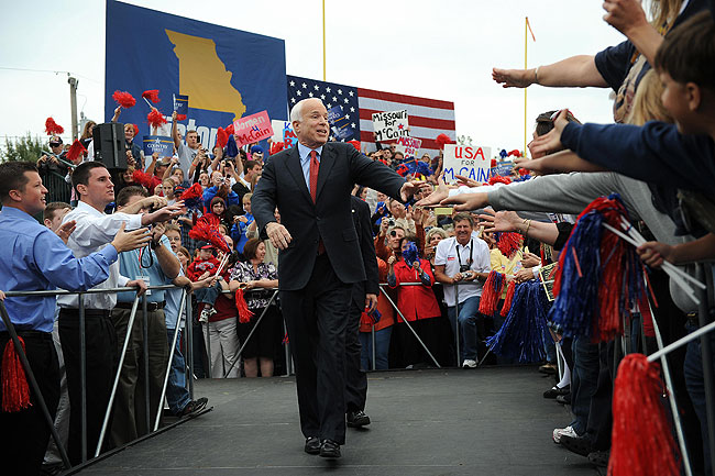Republican presidential candidate John McCain greets supporters as he arrives for a campaign rally at the Heartland High School & Academy in Belton, Missouri on October 20, 2008.