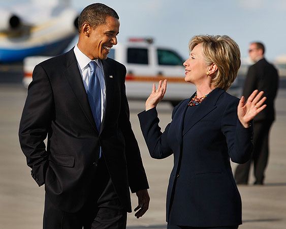 Democratic presidential nominee U.S. Sen. Barack Obama (D-IL) and Sen. Hillary Clinton (D-NY) talk after walking off his plane as they head to a campaign rally at Amway Arena October 20, 2008 in Orlando, Florida.
