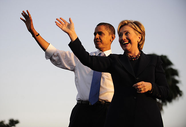 U.S. Democratic presidential candidate Illinois Senator Barack Obama and New York Senator Hillary Clinton address supporters during a rally at Amway Arena in Orlando, Florida, October 20, 2008.