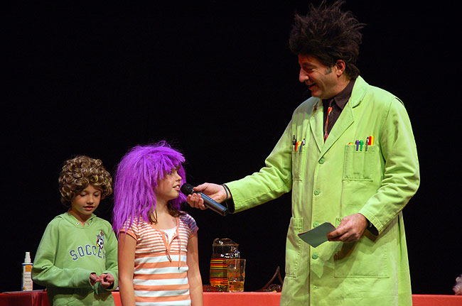 Paul Zaloom, as Beakman, asks an audience member a question during the audience participation portion of his stage show.