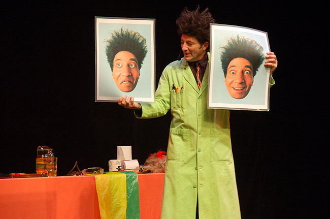 Zaloom holds up two photos of himself that have been altered to demonstrate how the brain perceives images.