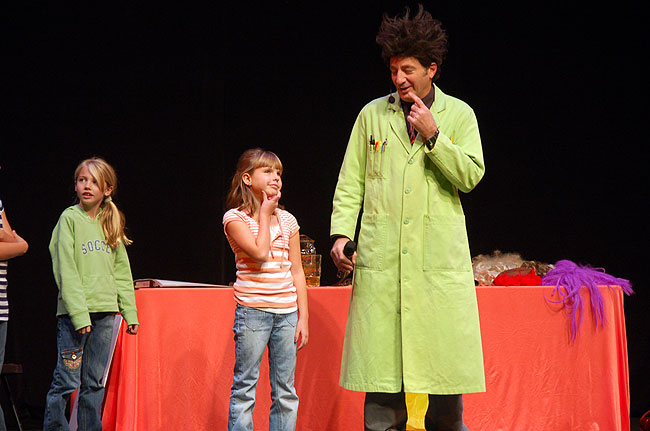 Zaloom, as Beakman, asks an audience member a question during his stage show.