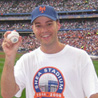 Zack Hample poses with his famous baseball.