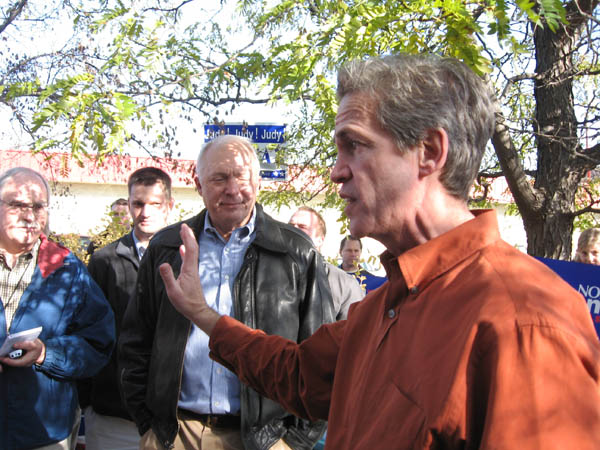 Sen. Norm Coleman, Republican candidate for U.S. Senate, speaks to reporters and supporters during a news conference today in Rosemount.
