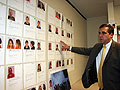 Sheriff Bob Fletcher points to a wall of mug shots