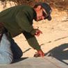 Ramiro Mora snaps a chalk line.