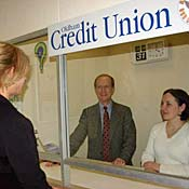 People in a credit union offfice.