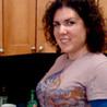 Sora Golob making latkes