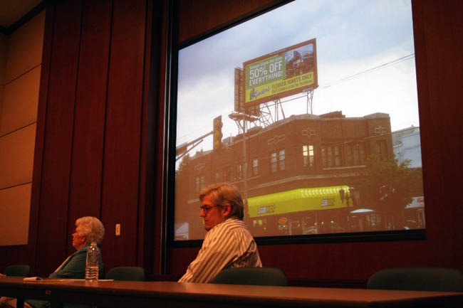 "Ruby Hunt and Gerry Mischke, members of the anti-billboard group Scenic St. Paul, listen to remarks at an unveiling of a slideshow depicting all 561 billboards in the city. The group says St. Paul is Minnesota's ""billboard capital."""