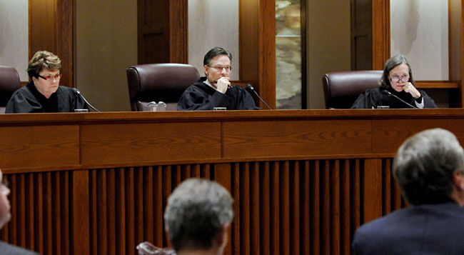A three-judge panel including Elizabeth Hayden of Stearns County, Kurt Marben of Pennington County and Denise Reilly of Hennepin County listen to arguments Wednesday on the motion by Democrat Al Franken, who is asking the court to dismiss the legal challenge brought by Republican Norm Coleman in the unresolved U.S. Senate race.