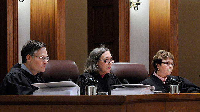 Judge Denise Reilly, center, asks a question as Judges Kurt Marben, left, and Elizabeth Hayden, right, listen during the Senate recount trial Tuesday, Jan. 27, 2009 in St. Paul, Minn.