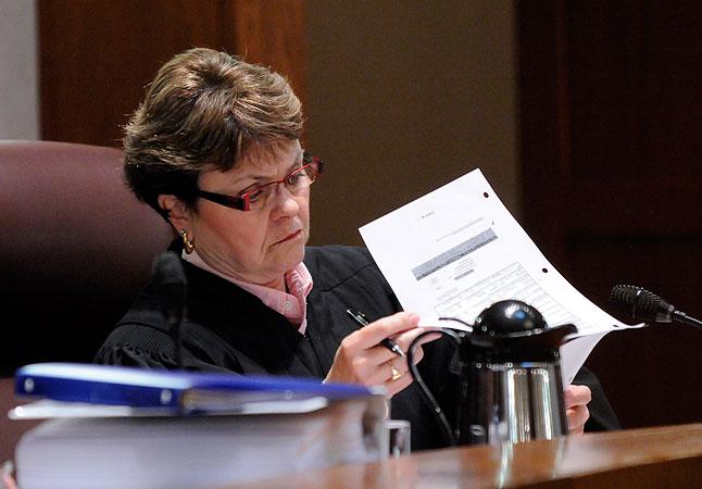 Judge Elizabeth Hayden studies an exhibit  during the Senate recount trial Tuesday, Jan. 27, 2009 in St. Paul, Minn.
