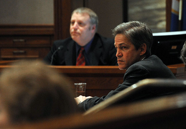 Norm Coleman listens to Attorney Joe Friedberg question Deputy Secretary of State Jim Gelbmann about absentee ballots.