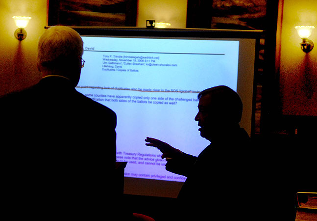 Attorney Joe Friedberg objects to an exhibit document which referred to absentee ballots with attorney David Lillehaug standing to the left.