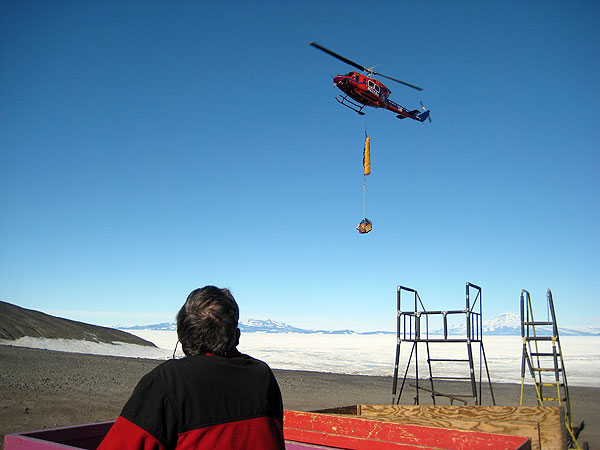 This image shows the team's sling load as it is about to be set down on the helopad at McMurdo Station.  Strong winds prevented the helicopter from taking the sling load when we were lifted out of camp on January 23.  Improved weather conditions fortunately allowed the sling load to be delived.
