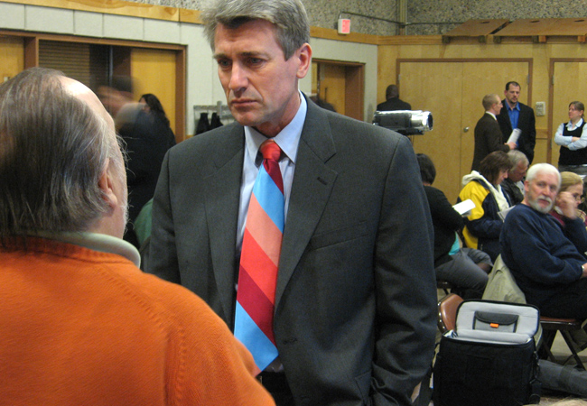 Mayor RT Rybak listens to a Minneapolis resident. Rybak is scheduled to present his budget plan in a few weeks.