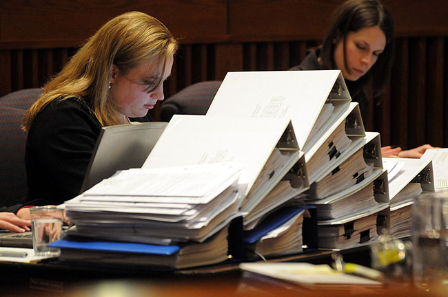 Jennifer Hobbs, left, and Sarah Sonday court clerks work alongside a mountain of  trial exhibits that grows daily in volume and size. Minnesota Judicial Center in St. Paul, Minn.