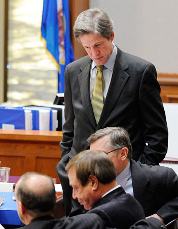 Former Republican Sen. Norm Coleman, standing, looks on as his attorneys, including Joe Friedberg, center, confer during a recess in the Senate vote recount trial Monday, March 2, 2009 in St. Paul, Minn.