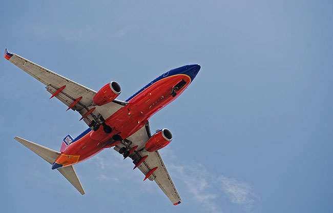A Southwest Airlines passenger jet makes its final approach to Tampa International Airport.