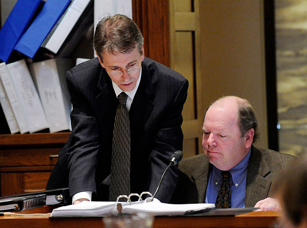 Al Franken attorney Kevin Hamilton, left, looks over an exhibit with Joe Mansky, election director for Ramsey COunty during the Senate vote recount trial Friday, March 6, 2009 in St. Paul, Minn.