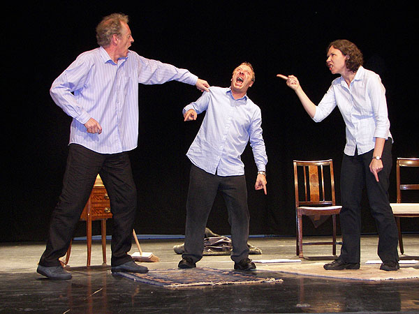 British performer Gary Stevens (center) performs in Ape along with Julian Maynard Smith (left) and Wendy Houstoun.