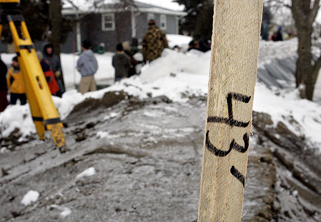 A stake placed on a dike marked the high end of a new projected crest of the Red River, in Moorhead Thursday, March 26, 2009.