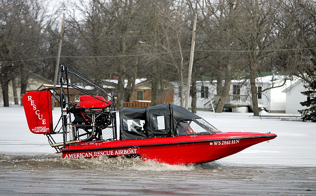 A rescue airboat moved to an evacuation area in the Oakport area Friday, March 27, 2009.