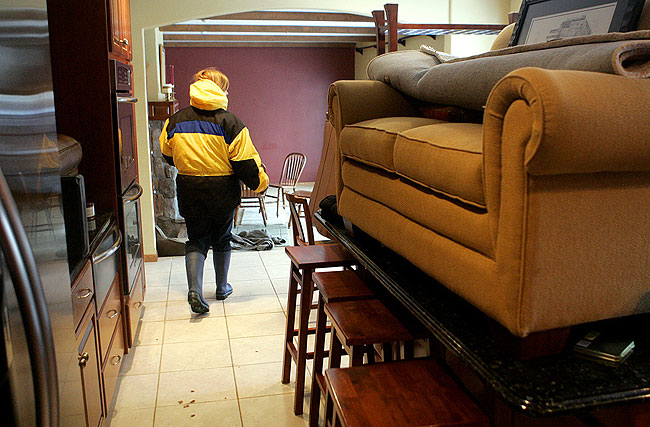 Donna Morse walked through her Moorhead home Friday, March 27, 2009, after she and her family had moved valuables to higher ground.