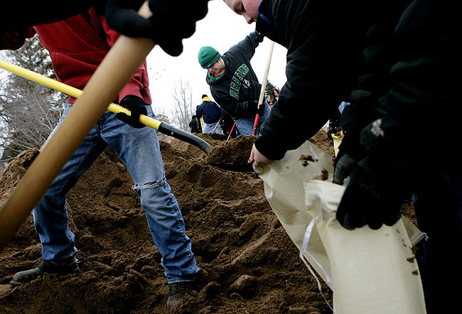 Students from Ada filled sandbags by hand on Main Street in Hendrum, Minnesota Monday, March 30, 2009.