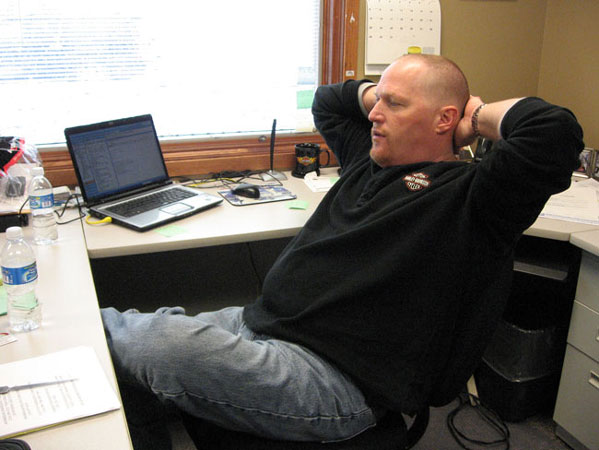 Joel Heitkamp hosts a popular talk radio show in the Fargo-Moorhead area. The station has been covering the flood for more than two months. Much of the staff has been sleeping over at the station for the last week to help with KFGOs 24-hour flood information coverage.