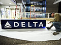 Installing the new Delta signage