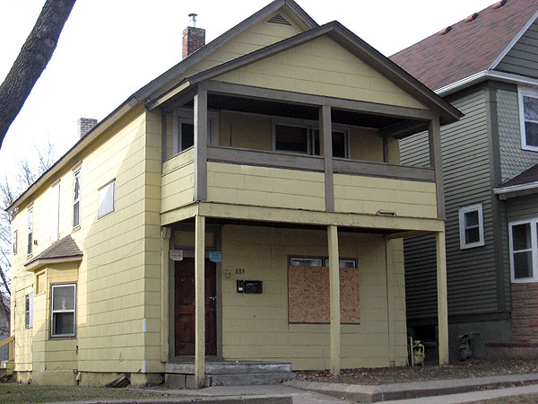 This boarded up house in St. Paul is one of about 2,000 vacant and foreclosed homes on the city's east side.