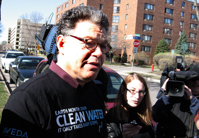 DFL Senate candidate Al Franken speaks to reporters following an Earth Day event in Minneapolis, April 22, 2009.