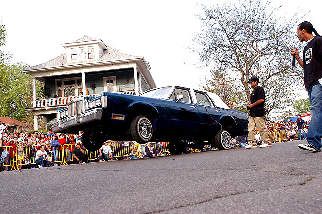A lowrider hops his car during a hydraulic showdown at a Cinco de Mayo celebration in Minneapolis.