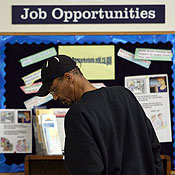 A job seeker looks at job listings