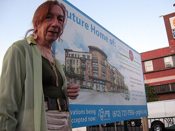 Barbara Satin, a transgendered activist, stands in front of the parking lot that she hopes will one day be replaced by the first gay-friendly senior home in the region.