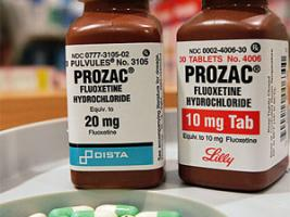 Two bottles of the anti-depressant drug Prozac are seen on a pharmacy shelf.