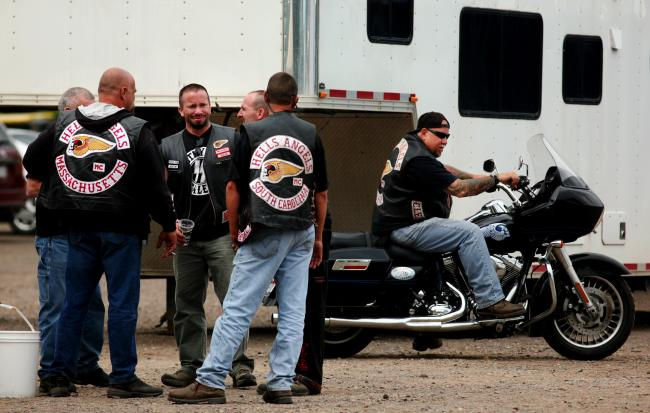 Members of the Hells Angels congregate near the entrance of the Lost Isle bar in Carlton, Minn. Wednesday. The members were in the Carlton area to kick off their annual Hells Angels USA Summer Ride.