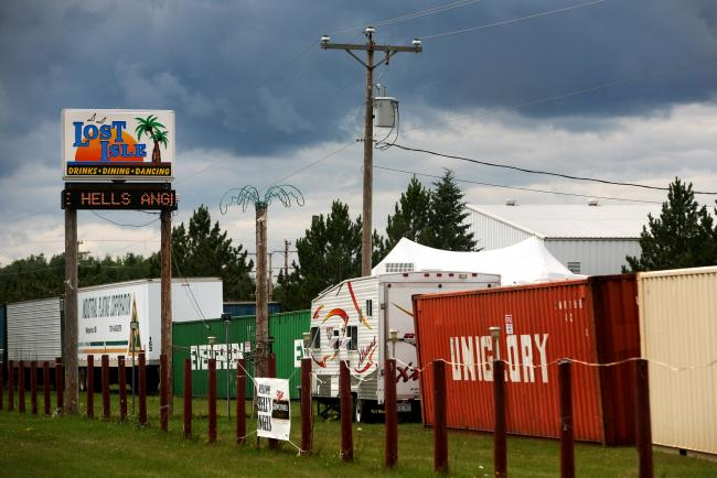 Members of the Hells Angels had the perimeter of the Lost Isle bar and restaurant in Carlton, Minn. blocked off with trailers and other vehicles.