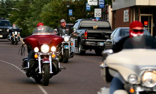 Members of the Hells Angels ride through the community of Carlton, Minn. Wednesday.