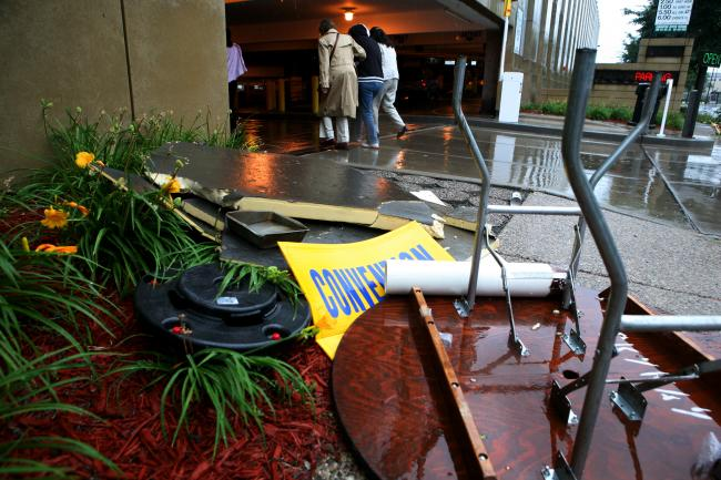Debris thrown around outside the Convention Center after severe weather swept through Minneapolis.