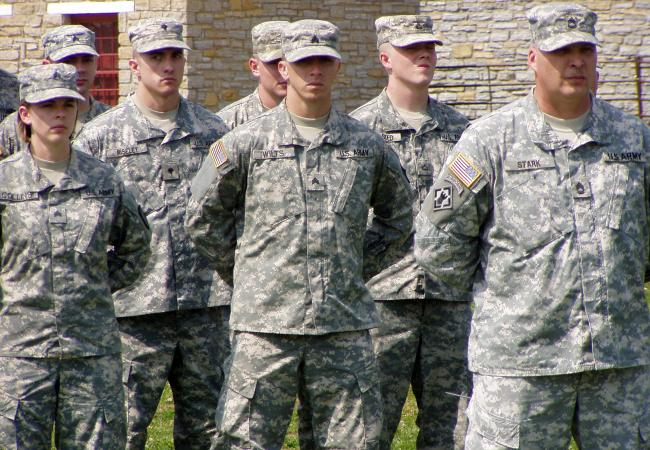 The men and women with the 372nd Engineer Brigade stand at attention during a deployment ceremony Monday at Fort Snelling.