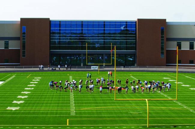 The new Farmington High School includes a football field that's close enough to the school to also be used during the day by physical education classes and extra-curricular programs.  The field, Tiger Stadium, has artificial turf.