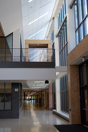 A well-lit hallway in the new Chanhassen High School.  The building is divided into four wings, each of which will house classrooms for a different grade.  The school's library will serve as a central point for the entire building.