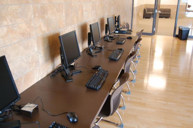 This computer room and the adjacent lounge area at Chanhassen High School will serve as common rooms where students can gather.  The building also features an auditorium that will be available to community groups, and new football and baseball fields for the new school's teams.
