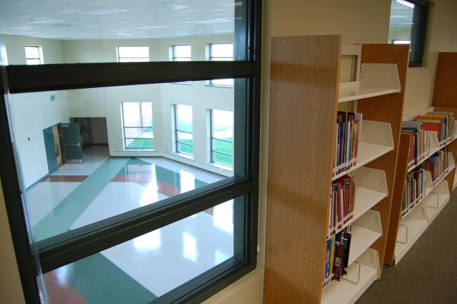 The library (media center) in the new Redtail Ridge Elementary School in Savage looks out over a spacious cafeteria that allows in a lot of natural light.  School leaders say the property includes acres of green space that will allow classes to spend time outside the building.