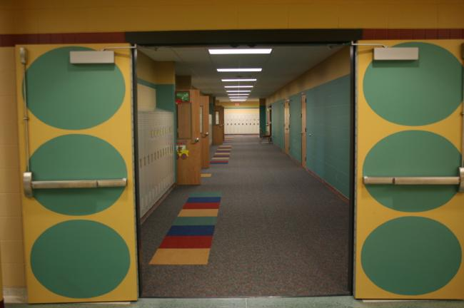 This hallway leads into the wing that will house first through third grades at the new elementary school in Chatfield, Minn.  The money to pay for the school was part of a bond that passed in 2007 by just 72 votes; it was the district's seventh attempt since 1996 to win voter approval.