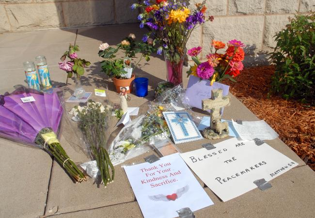 A makeshift memorial has sprung up outside the headquarters of the North St. Paul police department.