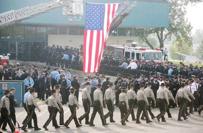 Hundreds of service officers file into Aldrich Arena for the funeral of Richard Crittenden in Maplewood Friday, Sept. 11, 2009.